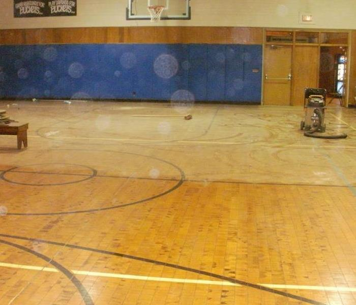 Damaged flooring in Gymnasium Before