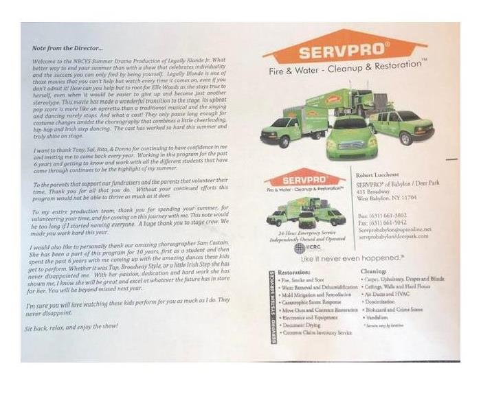 playbill from summer production with picture of SERVPRO vehicles inside
