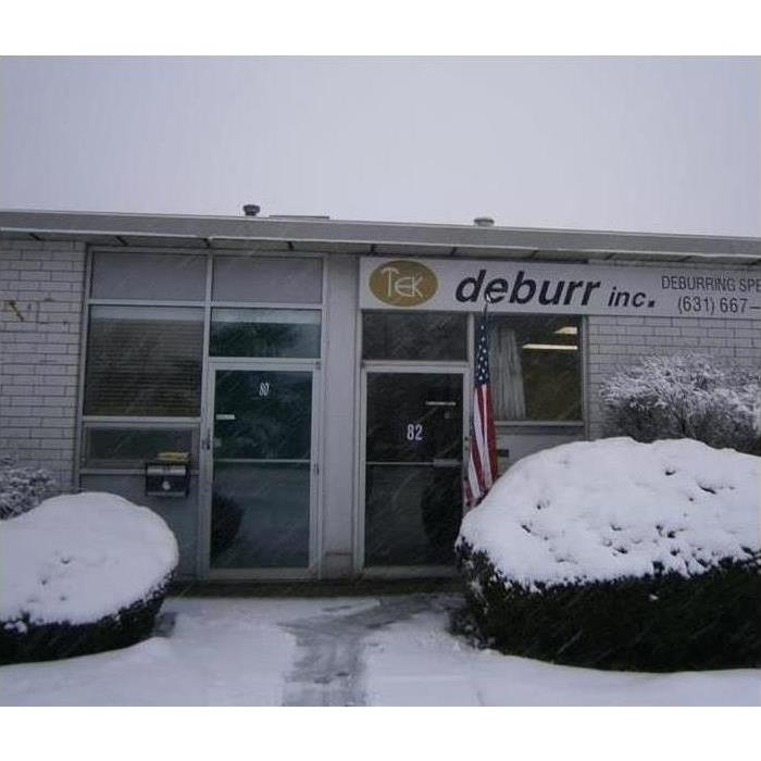 Picture of a business with snow on the ground