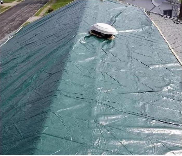 Tarp on roof of house